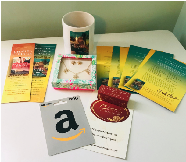 $100 Amazon Gift Card, Lilly Pulitzer palm tree necklace and earrings set, When We Left Cuba coffee mug, Besame cosmetics vintage-inspired lipstick, signed When We Left Cuba recipe cards, and signed When We Left Cuba bookmarks.